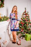 Christmas girl with gift. Girl in Christmas decorations with a gift with a good Christmas mood Royalty Free Stock Images