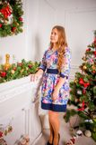 Christmas girl with gift. Girl in Christmas decorations with a gift with a good Christmas mood Royalty Free Stock Photo