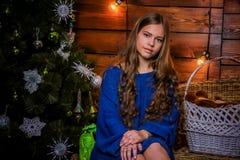 Christmas girl with gift. Girl in Christmas decorations with a gift with a good Christmas mood Stock Photo