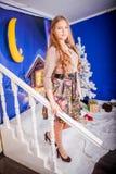 Christmas girl with gift. Girl in Christmas decorations with a gift with a good Christmas mood Stock Photos