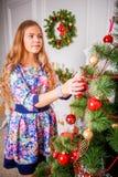 Christmas girl with gift. Girl in Christmas decorations with a gift with a good Christmas mood Stock Photography