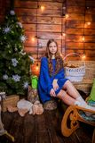 Christmas girl with gift. Girl in Christmas decorations with a gift with a good Christmas mood Stock Images