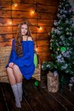 Christmas girl with gift. Girl in Christmas decorations with a gift with a good Christmas mood Royalty Free Stock Image
