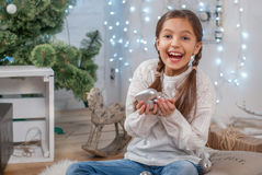 Girl with Christmas decorations. Girl holding Christmas decorations and laughs Stock Image