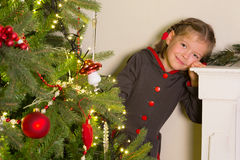 Girl in christmas dress Stock Photos