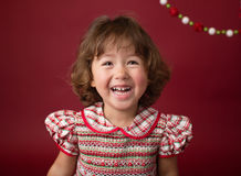 Girl in Christmas Dress, Outfit. Holiday Fashion Stock Image