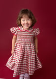 Girl in Christmas Dress, Outfit. Holiday Fashion Royalty Free Stock Photography