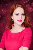 Girl with christmas earrings Stock Photo