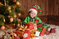 Girl - the Christmas elf with a gift Royalty Free Stock Photography