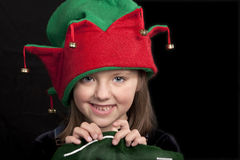 Girl in Christmas Elf hat Stock Photos