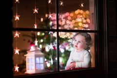 Girl at Christmas eve Stock Photos