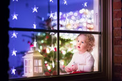 Girl at Christmas eve Stock Images