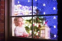 Girl at Christmas eve Stock Photos