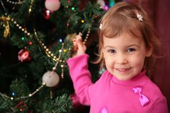 Girl and christmas fir 2 Royalty Free Stock Image
