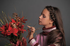Girl with Christmas flowers Stock Photography