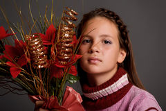 Girl with Christmas flowers Stock Images
