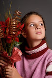 Girl with Christmas flowers Stock Photos