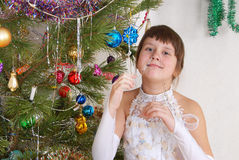 The girl at Christmas fur-tree. Royalty Free Stock Photos
