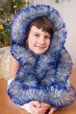 The girl at Christmas fur-tree. Royalty Free Stock Image