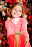 Girl with a Christmas gift Stock Image