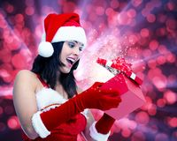 Girl with Christmas gift. Royalty Free Stock Photo