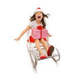 Girl with Christmas gift box on sled. Isolated white background Royalty Free Stock Images