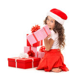 Girl with Christmas gift boxes. Isolated on white royalty free stock photos