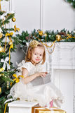 Girl and a Christmas gift. Royalty Free Stock Photography