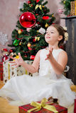 Girl with Christmas gift Royalty Free Stock Photography