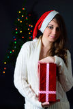 The girl with a Christmas gift Stock Photos