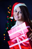 The girl with a Christmas gift Royalty Free Stock Photography