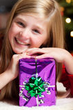 Girl with christmas gift smiling Royalty Free Stock Photos
