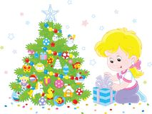 Girl with a Christmas gift. Vector illustration of a little girl with her holiday gift near a colorfully decorated Christmas tree Stock Photos