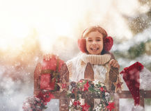 Girl with Christmas gift on a winter walk Stock Photo