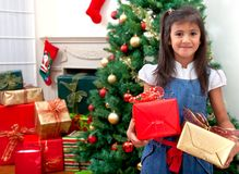 Girl with christmas gifts Royalty Free Stock Image
