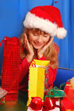 Girl and christmas gifts Stock Photography