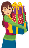 Girl with Christmas gifts Stock Images