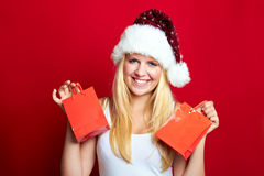 Girl on Christmas with gifts Royalty Free Stock Photos