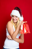 Girl on Christmas with gifts Royalty Free Stock Photography