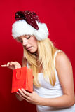 Girl on Christmas with gifts Stock Image
