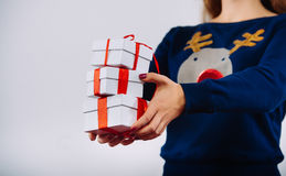 Girl with Christmas gifts in hands Royalty Free Stock Photos