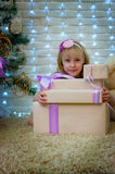 Girl and Christmas gifts Royalty Free Stock Photo