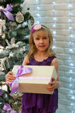 Girl and Christmas gifts Royalty Free Stock Photos