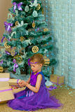 Girl and Christmas gifts Royalty Free Stock Photography
