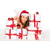 girl with Christmas gifts lying Stock Photos