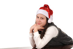 Girl in christmas hat Royalty Free Stock Image