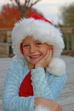 Girl in Christmas Hat Stock Images