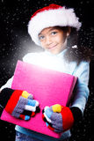Girl in Christmas hat Royalty Free Stock Photos