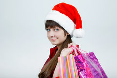 A girl in a Christmas hat Stock Images