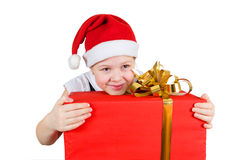 Girl in christmas hat with big red gift box Stock Photo